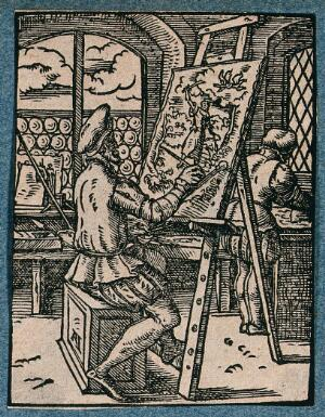 view An artist is painting a picture at an easel in his studio. Woodcut.