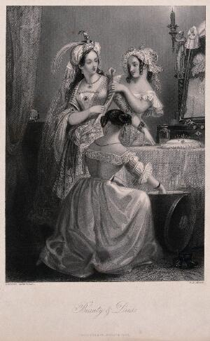 view Three young women are dressing in ornate clothes in front of a dressing table. Engraving by W.H. Mote after Edward Corbould.