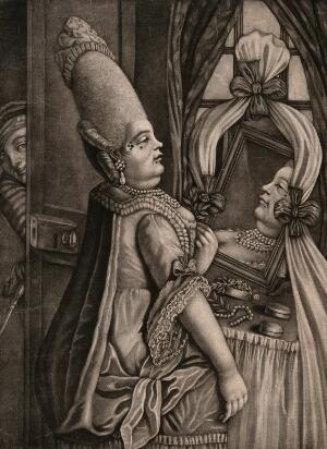 view A woman in a fine dress with pearls around her neck, a very elaborate hair style and beauty spots is sitting in front of a mirror admiring herself as a man peers at her through the door.