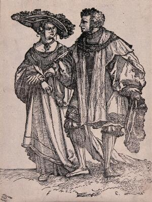 view A couple in fashionable dress. Woodcut
