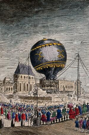 view Crowds of people are watching in the streets as a hot-air balloon leaves the ground. Coloured etching after Char. de Lovinier.
