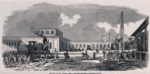 view A train has arrived at a station to be welcomed by crowds of people with banners. Wood engraving.