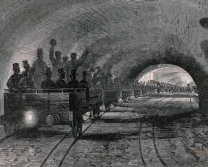 view A trial journey on the first part of the underground railway in London. Wood engraving, 1862.