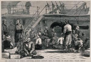 view Men in chains are on board a ship with a guard watching them from the rail. Wood engraving after H.J & Co.