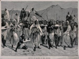 view A long line of men are marching with their hands thrust through holes in planks of wood as their captors and guards force them to walk across the desert. Wood engraving.
