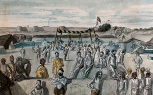 view India : a gathering of Hindu ascetics (sadhus) at a religious festival: in the background, the Union flag flies over a British military fortification. Watercolour, ca. 1880 (?).