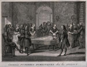 view A corpse is dressed in grave clothes and layed out for mourners to visit. Etching with engraving.