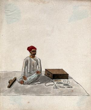 view A jeweller displaying samples of his jewellery. Gouache painting by an Indian artist.