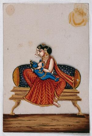 view Lord Krishna as a baby drinking milk from his foster mother. Gouache painting on mica by an Indian artist.