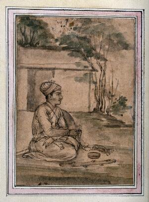 view A seated Mughal court attendant in a garden. Gouache preparatory painting, by an Indian artist, Mughal period.