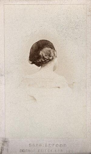 view A young girl wearing a hairnet, with plaited hair: the back of her head: a vignetted head-and-shoulders portrait. Photograph, 1870/1890.