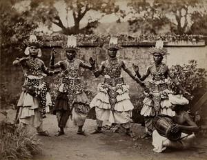 view Sri Lanka: traditional 'devil dancers' in costume. Photograph, ca. 1860.