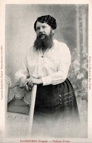 view Madame Delait, the bearded woman of Plombières, head and shoulders portrait. Photographic postcard by Scherr, 1923.