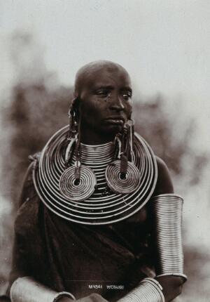 view A young Masai tribeswoman, wearing much jewellery. Photograph, ca.1900.