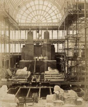 view The Crystal Palace during its re-erection at Sydenham, London: sphinxes in the unfinished interior. Photograph by Philip Delamotte, ca. 1854.