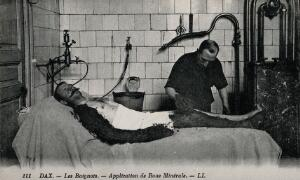 view Mud being applied on a patient of a thermal establishment in Dax, France. Photographic postcard, ca. 1920.