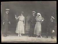 view Sailors, some in drag, performing a scene on stage. Photographic postcard, 191-.