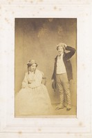 view Two men, one in drag, posing with comic expressions. Photograph, 189-.