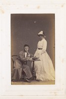 view Two men, one in drag, acting out a scene. Photograph, 189-.