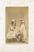 view Two men in drag (?) sitting opposite each other. Photograph, 189-.