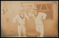 view Two sailors posing on the deck of a boat. Photographic postcard, 191-.