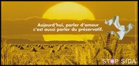 view Bales of wheat in a yellow field with a pair of white socks floating against a yellow sunset representing an advertisement for safe sex; French version of a series of 'Stop SIDA' [Stop AIDS] campaign posters by the Federal Office of Public Health, in collaboration with l'Aide Suisse contre le SIDA. Colour lithograph.